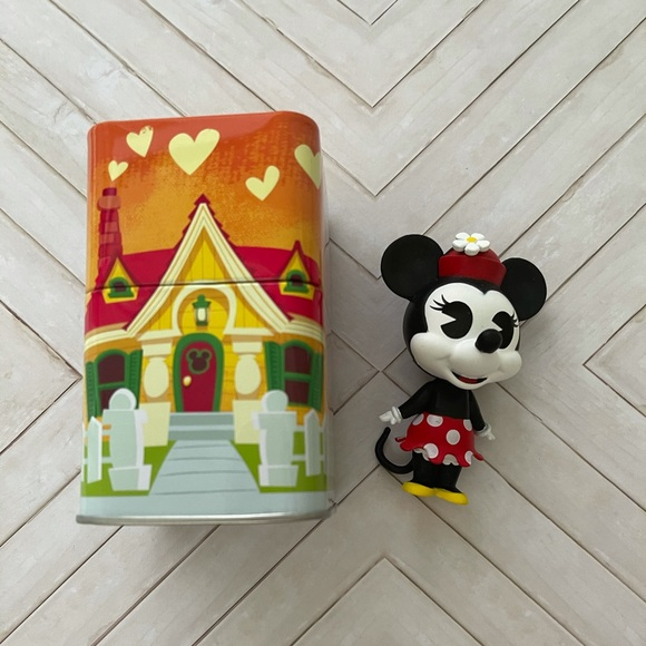 Minnie Mouse and tin funko exclusive